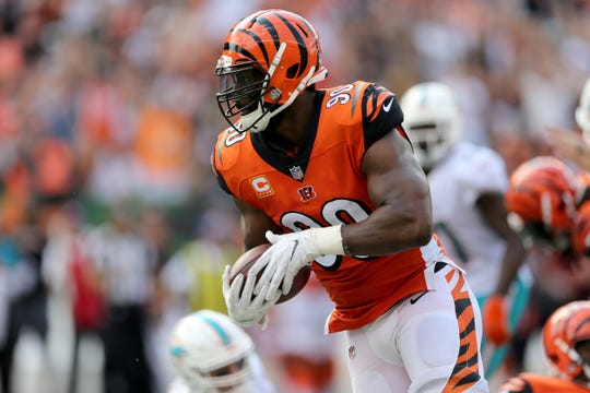 Cincinnati Bengals defensive end Michael Johnson (90) returns an interception for a touchdown in the fourth quarter during the Week 5 NFL game between the Miami Dolphins and the Cincinnati Bengals, Sunday, Oct. 7, 2018, at Paul Brown Stadium in Cincinnati. Cincinnati 27-17.