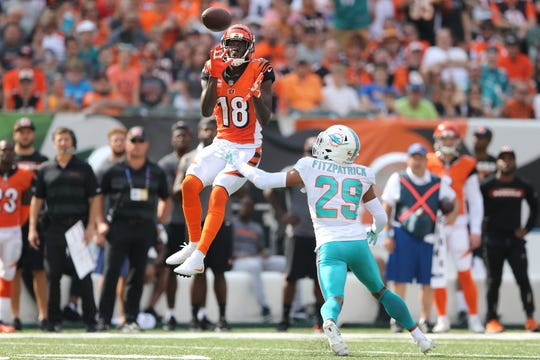 Cincinnati Bengals wide receiver A.J. Green (18) completes a catch as Miami Dolphins free safety Minkah Fitzpatrick (29) in the third quarter during the Week 5 NFL game between the Miami Dolphins and the Cincinnati Bengals, Sunday, Oct. 7, 2018, at Paul Brown Stadium in Cincinnati. Cincinnati 27-17.