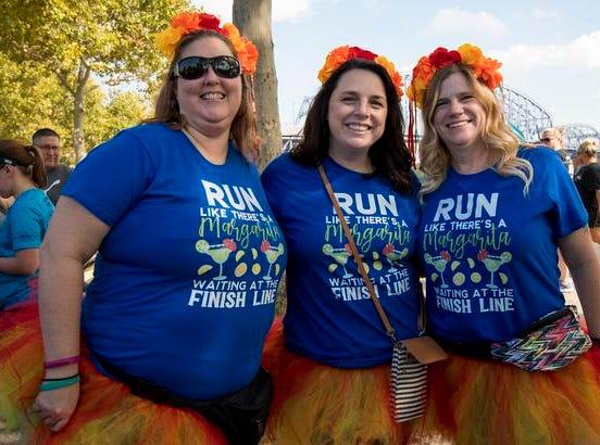 Kim Hacker, Carla Grimm and Heather Taylor of Colerain attend the Margarita Madness 5K race through Sawyer Point Saturday in Cincinnati.