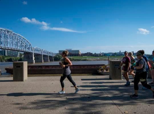 Participants run through Sawyer Point during the Margarita Madness 5K race Saturday in Cincinnati.