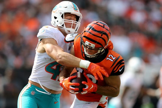 Cincinnati Bengals wide receiver Alex Erickson (12) completes a catch as Miami Dolphins linebacker Kiko Alonso (47) defends in the third quarter during the Week 5 NFL game between the Miami Dolphins and the Cincinnati Bengals, Sunday, Oct. 7, 2018, at Paul Brown Stadium in Cincinnati. Cincinnati 27-17.