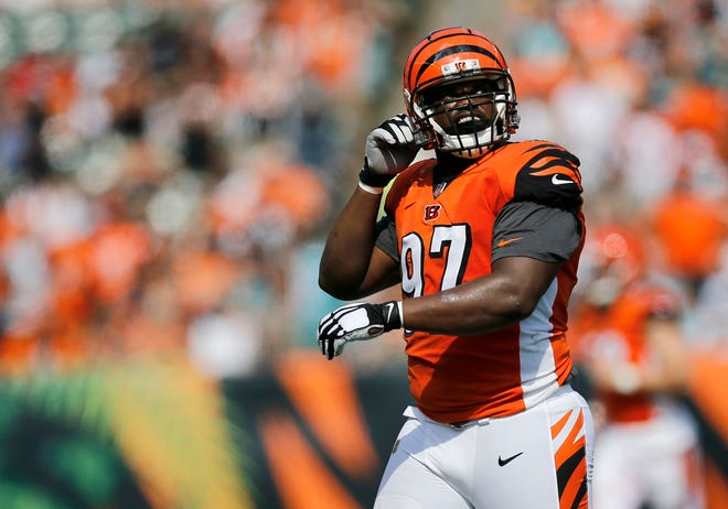 Cincinnati Bengals defensive tackle Geno Atkins (97) looks to the video board as he comes off the field in the first quarter of the NFL Week 5 game between the Cincinnati Bengals and the Miami Dolphins at Paul Brown Stadium in downtown Cincinnati on Sunday, Oct. 7, 2018. The Dolphins led 14-0 at halftime.