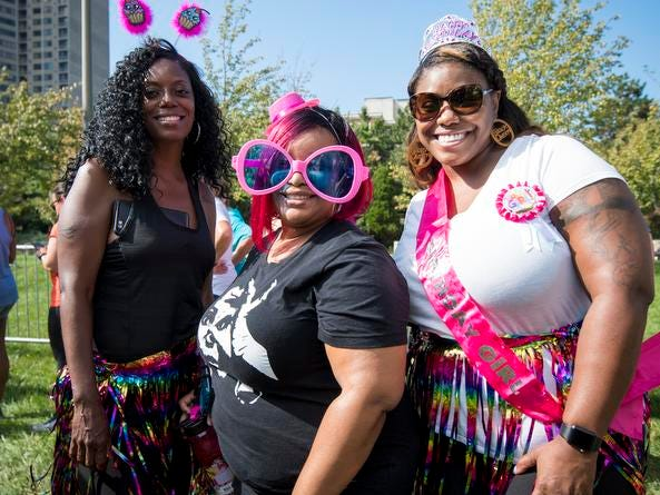 Mika Johnson and Janel and Annette Wheatley attend the Margarita Madness 5K race through Sawyer Point Saturday in Cincinnati.