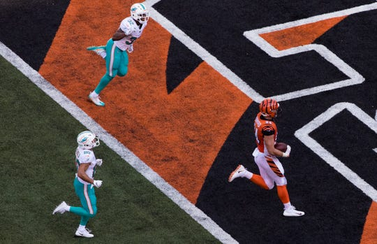 Cincinnati Bengals defensive end Sam Hubbard (94) scores a touchdown during a Week 5 NFL game between the Cincinnati Bengals and the Miami Dolphins, Sunday, Oct. 7, 2018, at Paul Brown Stadium in Cincinnati.