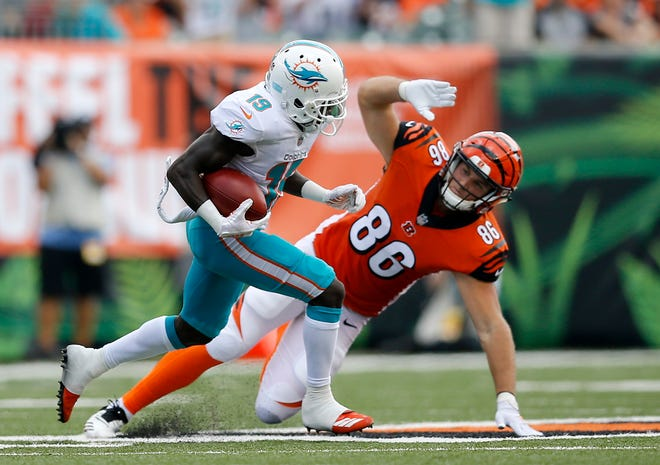 Miami Dolphins wide receiver Jakeem Grant (19) cuts ahead of Cincinnati Bengals tight end Mason Schreck (86) on a punt return for a touchdown in the second quarter of the NFL Week 5 game between the Cincinnati Bengals and the Miami Dolphins at Paul Brown Stadium in downtown Cincinnati on Sunday, Oct. 7, 2018. The Dolphins led 14-0 at halftime.