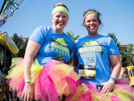 Amber Richardson of Milford and Wendy Woodruff of Mariemont attend the Margarita Madness 5K race through Sawyer Point Saturday in Cincinnati.