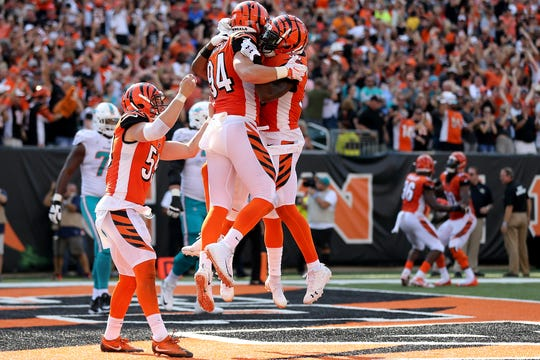 Cincinnati Bengals defensive end Sam Hubbard (94) is congratulated after scoring an interception return for a touchdown in the fourth quarter during the Week 5 NFL game between the Miami Dolphins and the Cincinnati Bengals, Sunday, Oct. 7, 2018, at Paul Brown Stadium in Cincinnati. Cincinnati 27-17.