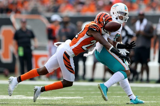 Cincinnati Bengals cornerback William Jackson (22) breaks up a pass intended for Miami Dolphins wide receiver Albert Wilson (15) in the second quarter during the Week 5 NFL game between the Miami Dolphins and the Cincinnati Bengals, Sunday, Oct. 7, 2018, at Paul Brown Stadium in Cincinnati.