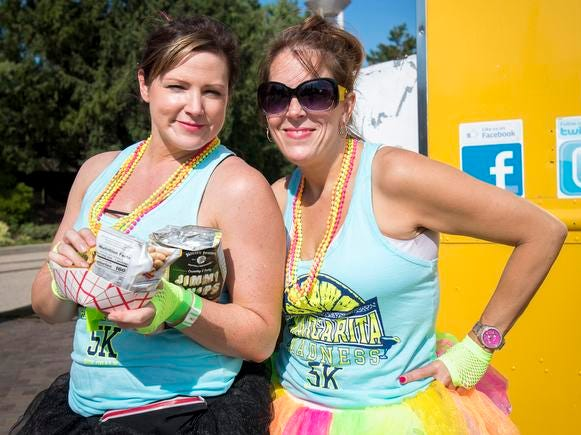 Cindy Temple and Teresa Slone attend the Margarita Madness 5K race through Sawyer Point Saturday in Cincinnati.