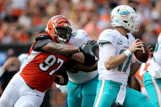 Cincinnati Bengals defensive tackle Geno Atkins (97) pressures Miami Dolphins quarterback Ryan Tannehill (17) in the first quarter during the Week 5 NFL game between the Miami Dolphins and the Cincinnati Bengals, Sunday, Oct. 7, 2018, at Paul Brown Stadium in Cincinnati.