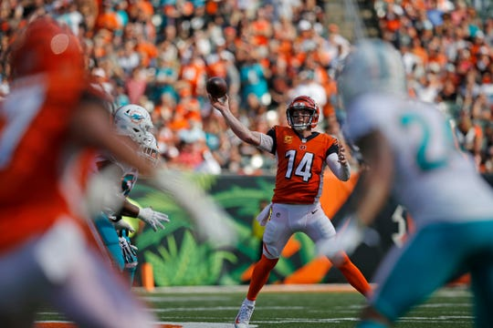 Cincinnati Bengals quarterback Andy Dalton (14) throws on the run in the third quarter of the NFL Week 5 game between the Cincinnati Bengals and the Miami Dolphins at Paul Brown Stadium in downtown Cincinnati on Sunday, Oct. 7, 2018. The Bengals overcame a 14-0 deficit to win 27-17.