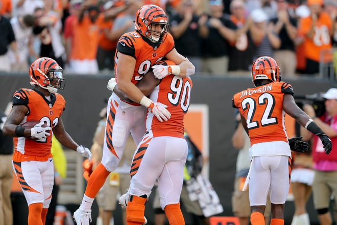 Cincinnati Bengals defensive end Sam Hubbard (94) is lifted up by Cincinnati Bengals defensive end Michael Johnson (90) after scoring an interception return for a touchdown in the fourth quarter during the Week 5 NFL game between the Miami Dolphins and the Cincinnati Bengals, Sunday, Oct. 7, 2018, at Paul Brown Stadium in Cincinnati. Cincinnati 27-17.