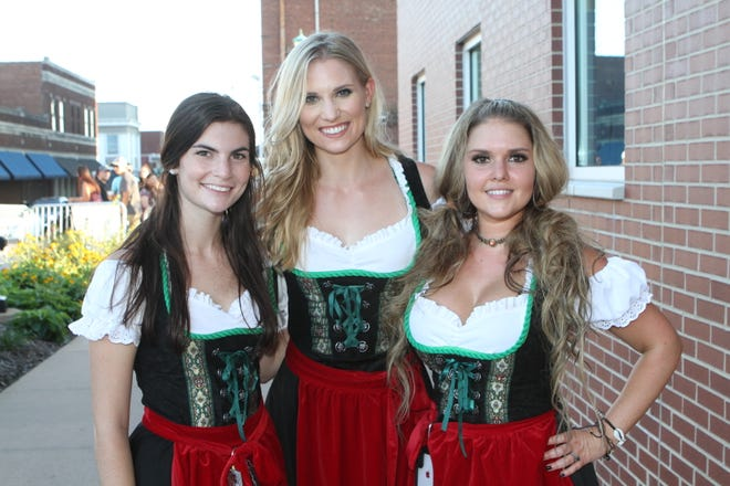 Jodi Felts, Jessica Cost and Katie Nelson Downtown Commons on Saturday, Oct. 6, 2018, for the inaugural Bikers Who Care Oktoberfest.