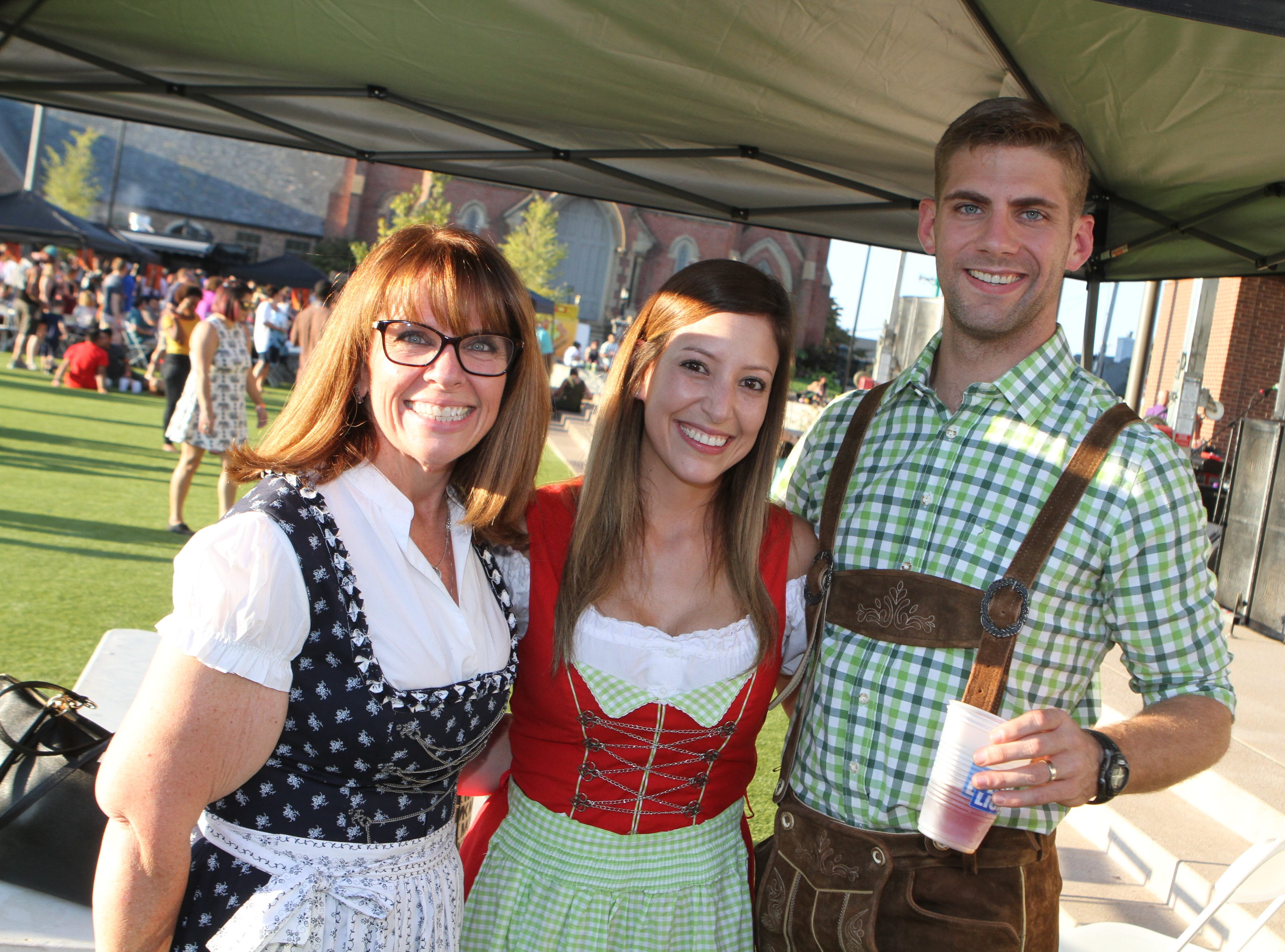 Kathy Nelson, and Maria and Chris Nelson at Downtown Commons on Saturday, Oct. 6, 2018, for the inaugural Bikers Who Care Oktoberfest.