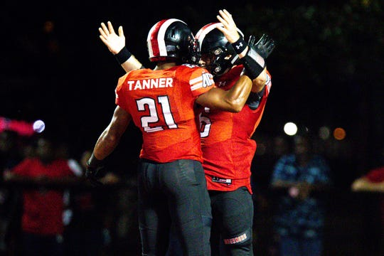 Austin Peay Governors quarterback Jeremiah Oatsvall (6) is celebrated by Austin Peay Governors running back Ahmaad Tanner (21) after Oatsvall's touchdown during the second half at Fortera Stadium Saturday, Oct. 6, 2018, in Clarksville, Tenn.
