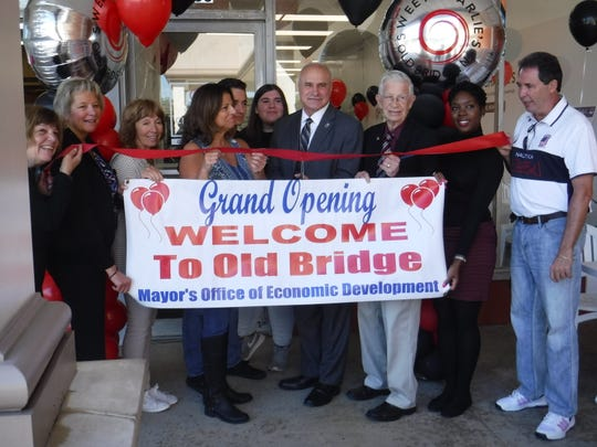 """Old Bridge Mayor, Owen Henry, presents Sweet Charlie's owner, Tina Kelly, with """"Welcome To Old Bridge"""" certificate from the township's """"Mayor's Office of Economic Development"""" on Saturday, Sept. 29. For video, visithttps://drive.google.com/file/d/1DmgKoE97vs1fC7a7P6AU5iX675zf7SkB/view?usp=drivesdk."""