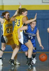 Jessica Wells dribbles past a Colonia defender during a 2014 game.