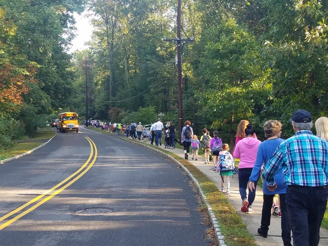 Students at Marion T. Bedwell Elementary School in Bernardsville take the walking school bus to school.  Students across Somerset County will lace up their sneakers and strap on bicycle helmets to participate in National Walk and Bike to School events throughout the month.