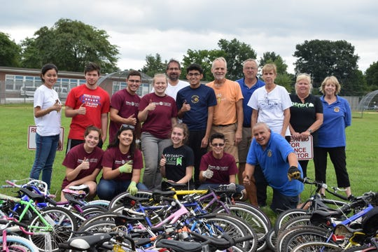 Rotarians and Rotaract working together to collect bikes for those in need.