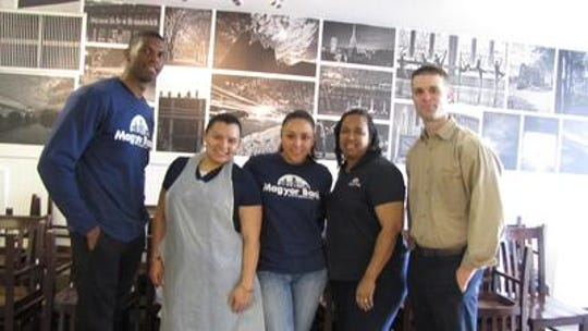Jessica Wells, second from left, and her Magyar Bank colleagues volunteered at Elijah's Promise