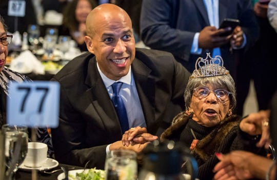 New Jersey Sen. Cory Booker greets the audience at the Iowa Democratic Party's fall gala Saturday, Oct. 6, 2018, at the Iowa Events Center in Des Moines.