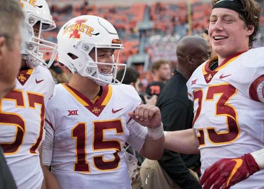 Iowa State quarterback Brock Purdy (15) celebrates with teammates after the game against Oklahoma State at Boone Pickens Stadium.