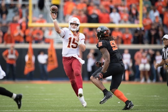 Iowa State Cyclones quarterback Brock Purdy (15) passes while being defended by Oklahoma State Cowboys defensive end Mike Scott (91) during the second half on Oct 6, 2018 at Boone Pickens Stadium in Stillwater, Oklahoma.