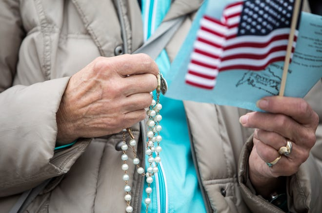Hundreds pray the Rosary on the Detroit Riverwalk at the same time as many across America as part of Rosary Coast to Coast, in Detroit, Sunday, Oct 7, 2018.
