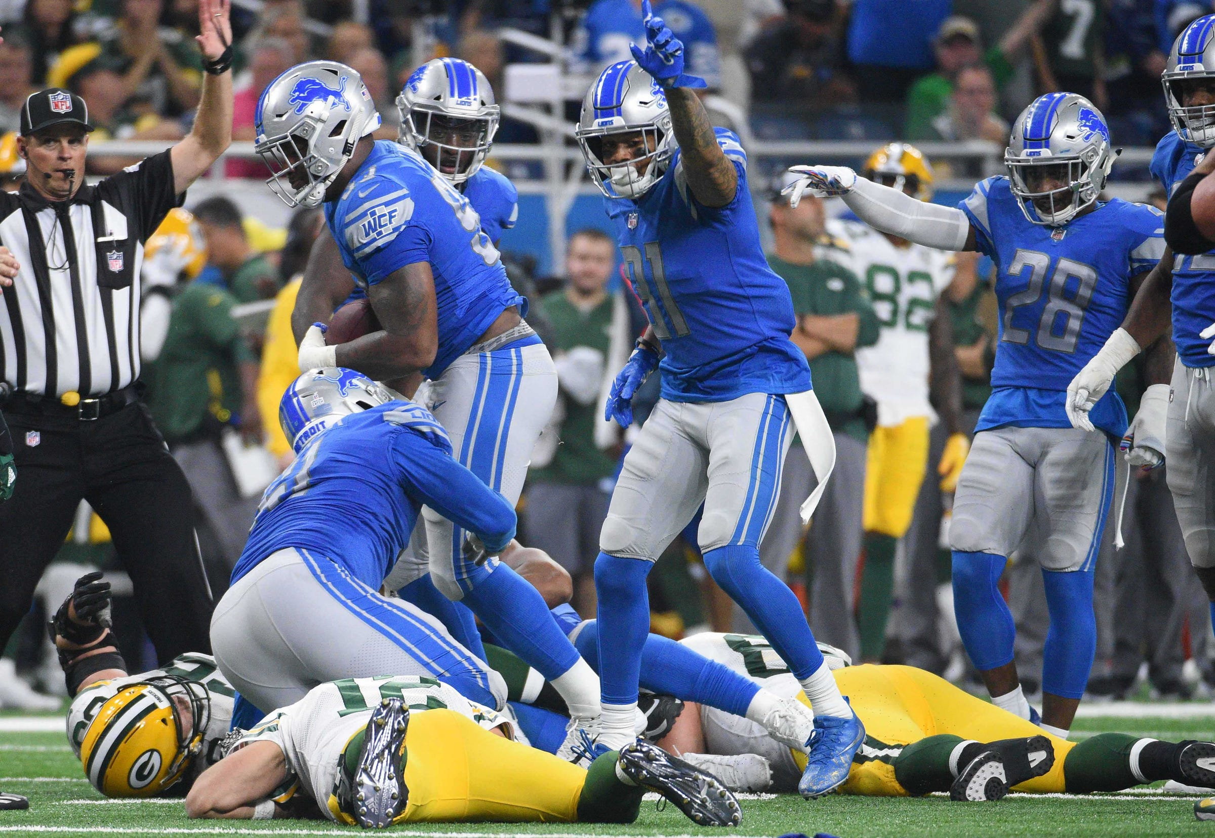 Lions cornerback Teez Tabor (31) reacts after teammates recovered Packers quarterback Aaron Rodgers' fumble .
