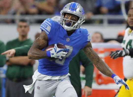 Detroit Lions receiver Kenny Golladay makes a catch over Green Bay Packers safety Josh Jones during the first half Sunday, October 7, 2018 at Ford Field in Detroit.