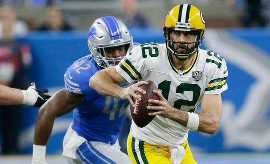 Green Bay Packers quarterback Aaron Rodgers is chased by Detroit Lions linebacker Devon Kennard during the first half Sunday, Oct. 7, 2018, in Detroit.