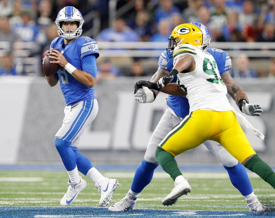 Lions quarterback Matthew Stafford looks for an open man during the first half on Sunday, Oct. 7, 2018, at Ford Field.