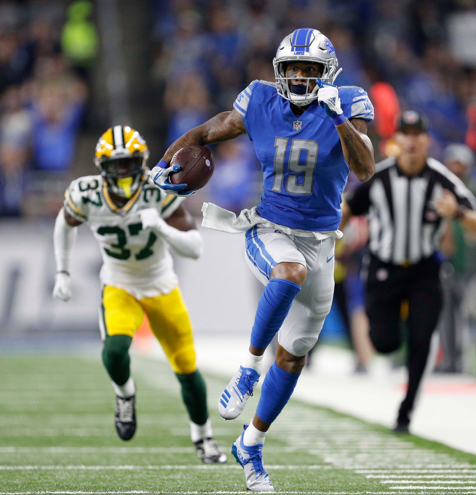 Lions wide receiver Kenny Golladay runs after a catch during the first quarter against Green Bay Packers cornerback Josh Jackson at Ford Field.