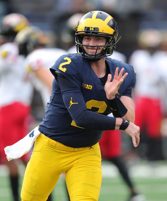 f7770839b9e0f4 Shea Patterson warms up before a game earlier this season. (Photo  Kirthmon  F. Dozier