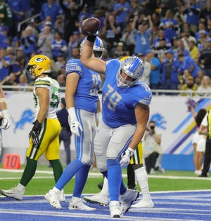 Detroit Lions' Kenny Wiggins spikes the ball after a first-half touchdown against the Green Bay Packers, Sunday, Oct. 7, 2018 at Ford Field.