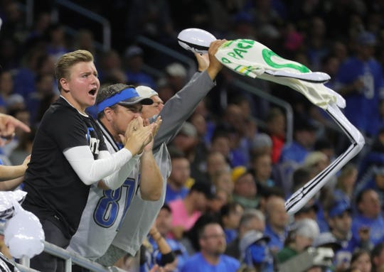 Detroit Lions fans cheer during a break in the action against the Green Bay Packers, Sunday, Oct. 7, 2018 at Ford Field.