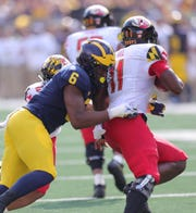 Michigan's Josh Uche sacks Maryland's Kasim Hill during the second half Saturday, Oct. 6, 2018 at Michigan Stadium.