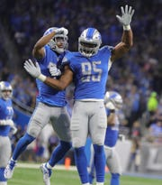 Detroit Lions' Romeo Okwara (95) celebrates causing a fumble by Green Bay Packers quarterback Aaron Rogers during the first half Sunday, Oct. 7, 2018 at Ford Field.