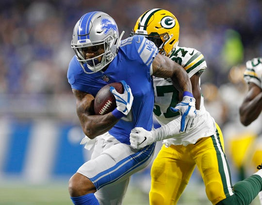 Lions wide receiver Kenny Golladay tries to run past Packers cornerback Josh Jackson after a catch during the first half on Sunday, Oct. 7, 2018, at Ford Field.