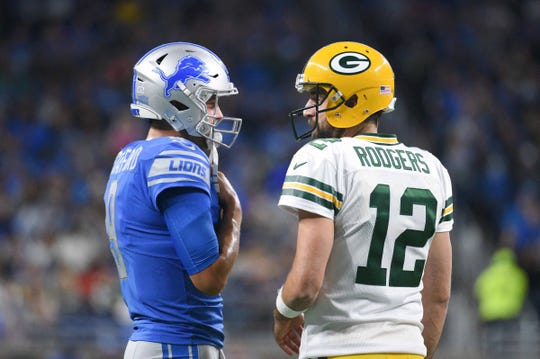 Lions quarterback Matthew Stafford and Packers quarterback Aaron Rodgers chat before the game Oct. 7, 2018, at Ford Field.