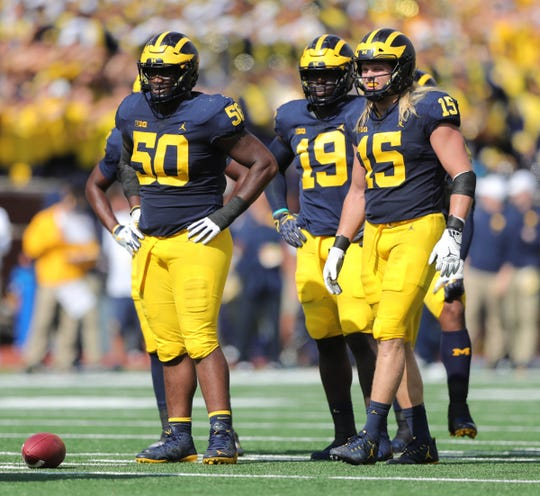 Michigan's Michael Dwumfour (50), Kwity Paye (19) and Chase Winovich (15) line up Oct. 6 against Maryland.
