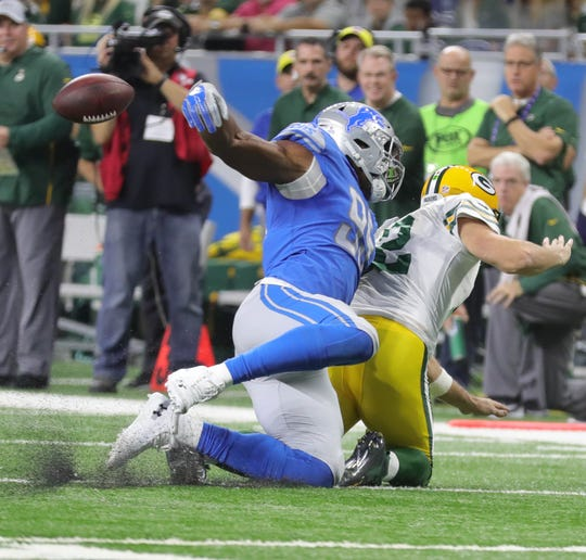 Detroit Lions defensive end Romeo Okwara forces a fumble by Green Bay Packers quarterback Aaron Rodgers during the first half Sunday, Oct. 7, 2018 at Ford Field in Detroit.