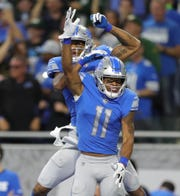 Detroit Lions receivers Marvin Jones Jr. (11) and Kenny Golladay celebrate during the first half against the Green Bay Packers, Sunday, Oct. 7, 2018 at Ford Field.