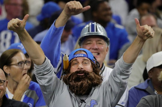 A Detroit Lions fan dressed like head coach Matt Patricia cheers during a break in the action against the Green Bay Packers Sunday, October 7, 2018 at Ford Field in Detroit, Mich.