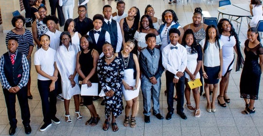 The students of homeroom 8B at Mary McLeod Bethune  Elementary-Middle School at their eighth-grade graduation ceremony. Eleven of 31 students didn't enroll in the school until eighth grade.