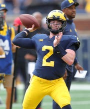 Michigan's Shea Patterson warms up before action against Maryland, Saturday, Oct. 6, 2018 at Michigan Stadium.