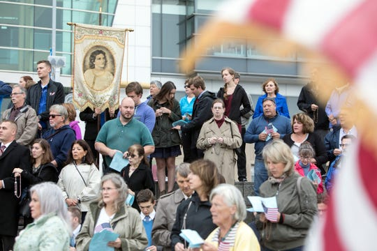 Hundreds gather to pray the Rosary on the Detroit Riverwalk as part of Rosary Coast to Coast, in Detroit, Sunday, Oct 7, 2018.