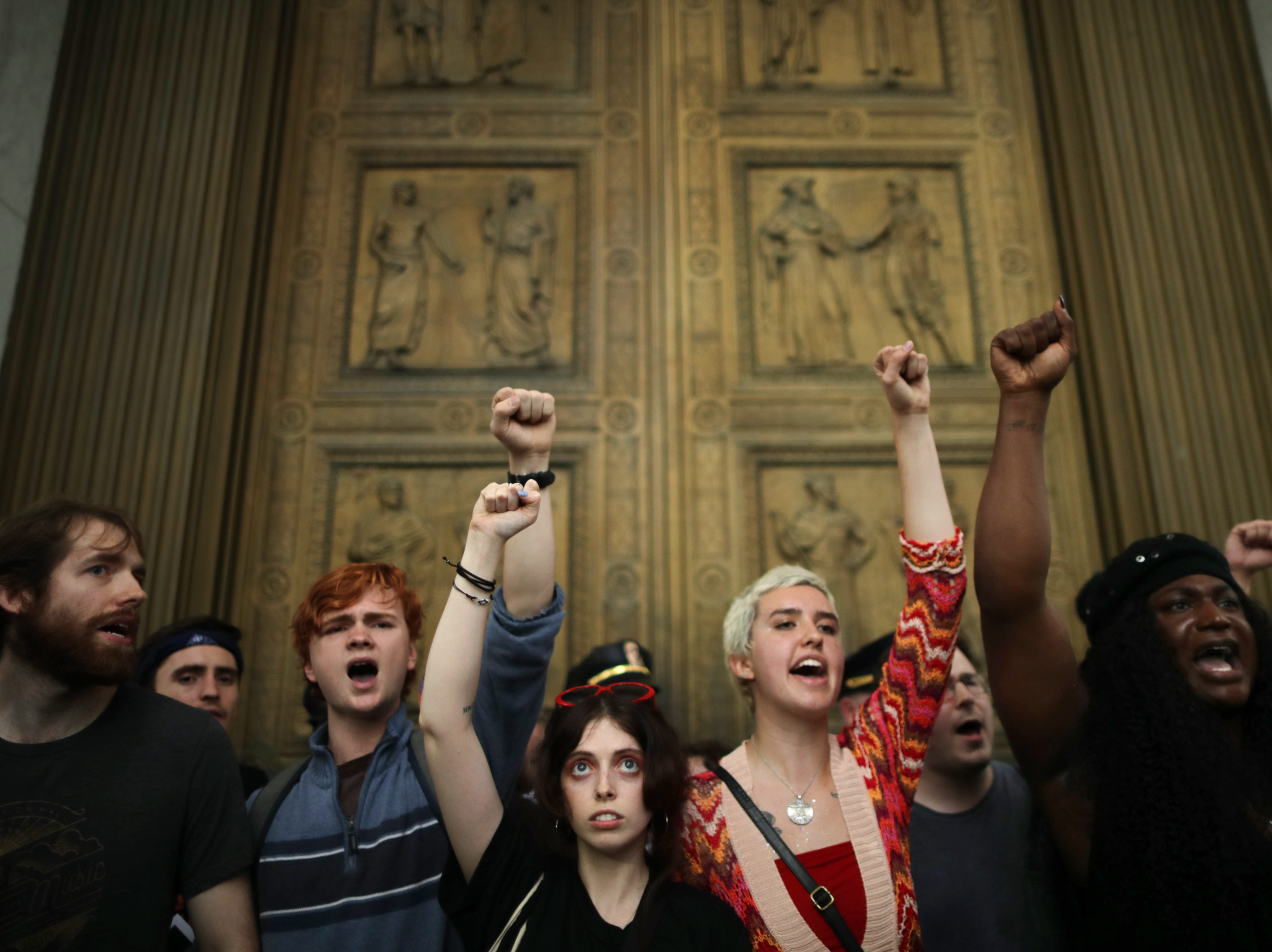 After overrunning police barricades, protesters chant as they block the doors to the U.S. Supreme Court while demonstrating against the confirmation of Associate Justice Brett Kavanaugh October 6, 2018, in Washington, D.C. The protesters marched up to the doors of the court as Kavanaugh was inside taking his oath.