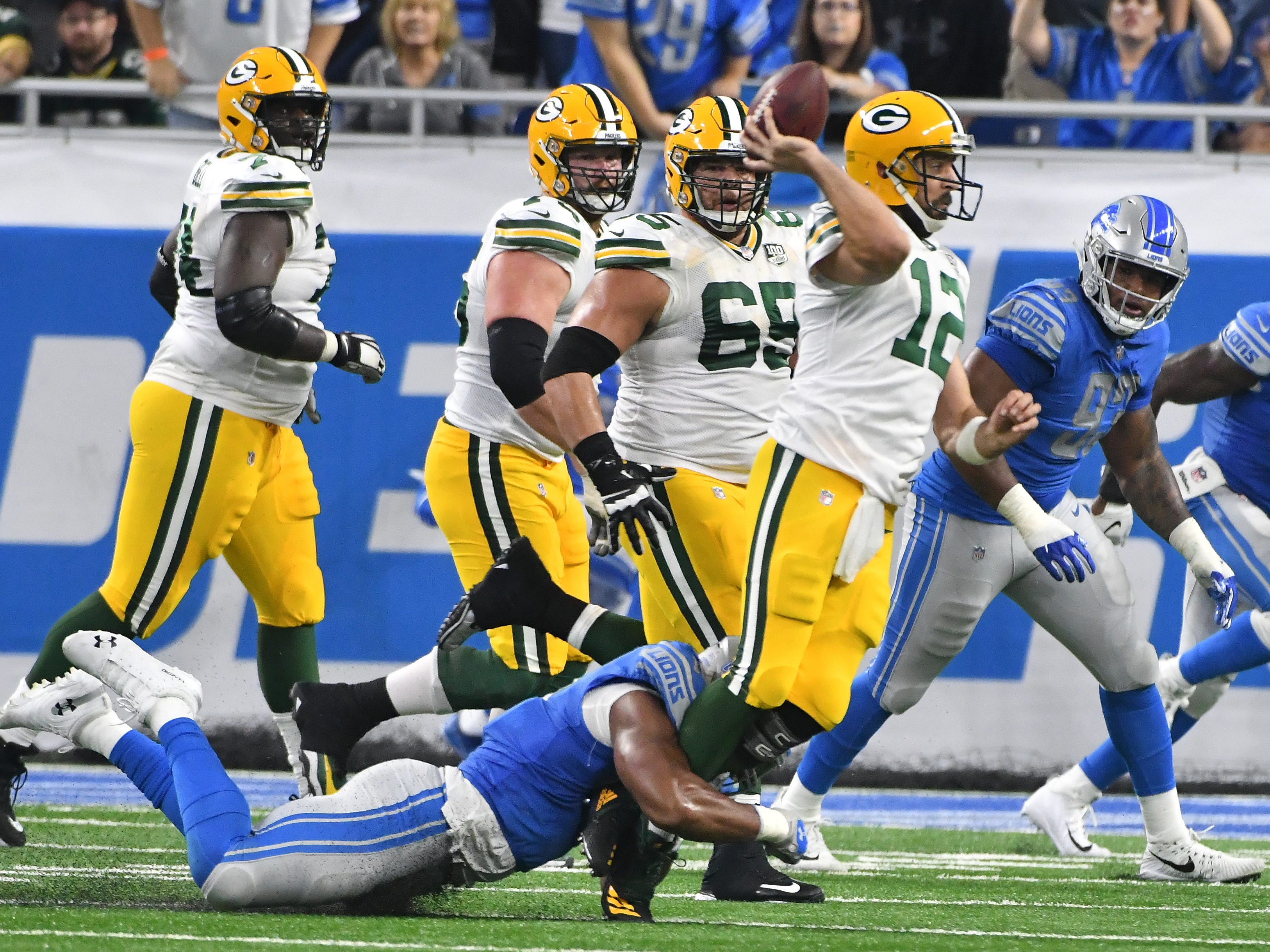Lions' Romeo Okwara pressures Packers quarterback Aaron Rodgers to throw the ball away in the second quarter.
