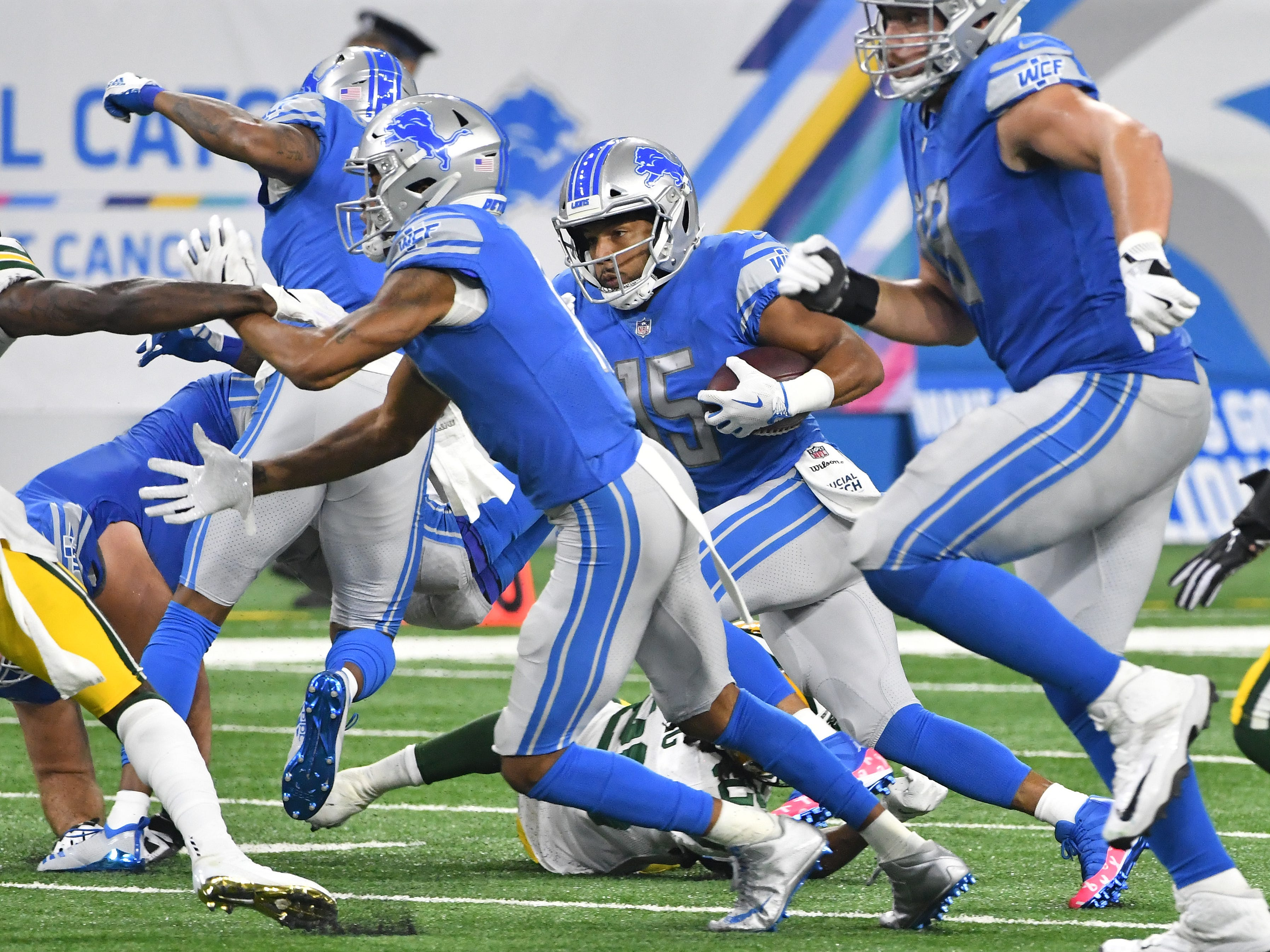 Lions wide receiver Golden Tate gets some blocking on a run in the second quarter.